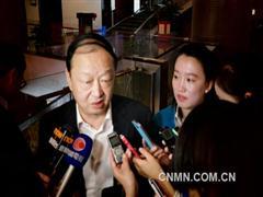 全国政协委员、中信集团集团董事长常振明参加完经济界别小组讨论后接受了本报记者的采访