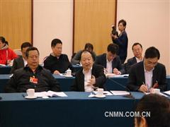 全国政协十二届三次会议教育界别小组讨论现场